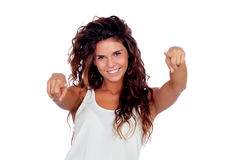 Natural girl with curly hair pointing at the camera. Isolated on a white background royalty free stock photo
