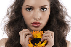Natural girl with long hair holding a sunflower Royalty Free Stock Images