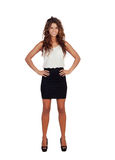 Natural girl with mini-skirt and curly hair. Isolated on a white background royalty free stock images