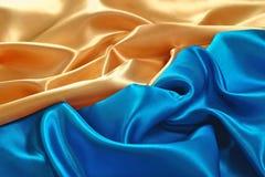 Natural golden and blue satin fabric texture stock photo