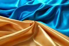 Natural golden and blue satin fabric texture royalty free stock photo