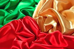 Natural golden, red and green satin fabric texture Royalty Free Stock Image