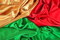Natural golden, red and green satin fabric texture Royalty Free Stock Photos