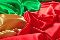 Natural golden, red and green satin fabric texture Stock Image