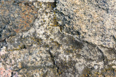 Natural granite rough stone. The old surface close up. Background. Royalty Free Stock Image