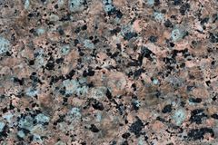 Natural granite texture with splashes of black, white and light brown stock image