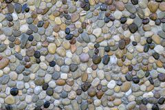 Natural gravel packing texture background, pebble wall royalty free stock photography
