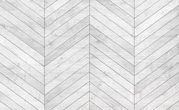 Natural gray wooden parquet herringbone. Wood texture. stock photography