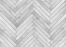Natural gray wooden parquet herringbone. Wood texture. Royalty Free Stock Photos