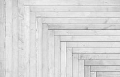 Natural gray wooden parquet herringbone. Wood texture. Stock Image