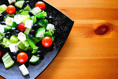 Natural Greek salad served on a plate Royalty Free Stock Photo