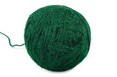 Natural green fine wool ball and thread isolated clew macro closeup studio shot detail large detailed royalty free stock image