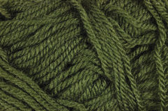 Natural green fine wool threads texture, horizontal textured clew macro closeup background pattern Royalty Free Stock Photo