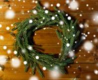 Natural green fir branch wreath on wooden board Stock Photo