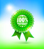 Natural green label 100%. 100% natural green label in blue sky Royalty Free Stock Photography