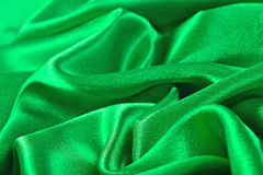 Natural green satin fabric texture background Stock Image