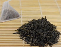 Natural green tea and tea bags Stock Photo