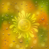 Natural green and yellow background. Drawn sun on the wet glass Stock Photography