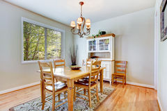 Natural grey dining room with wood table and cabinet. Royalty Free Stock Photos