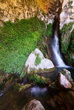 Natural grot with  waterfall. Cuerva dal Agua near Tiscar Stock Photos