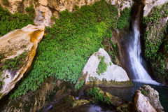 Natural grot with  waterfall. Cuerva dal Agua near Tiscar, Spain Stock Images