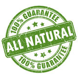 Natural guarantee stamp. On white background Stock Photos