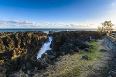 Natural gulf in volcanic rock at Reunion Island. Close to Etang Sale city Royalty Free Stock Photography