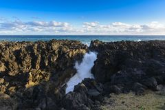 Natural gulf in volcanic rock at Reunion Island. Close to Etang Sale city Royalty Free Stock Images