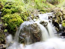 Natural gushing water, spout water, natural spring water. Long exposure stock images