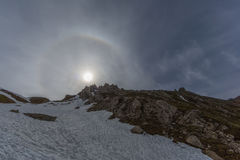 Natural halo with sun in blue sky and snowy mountains. Natural halo with sun in blue sky, ring and snowy mountains stock image