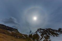 Natural halo, sun, cloud, mountains, grassland. Natural halo, sun, cloud, mountains with snow, grassland stock images