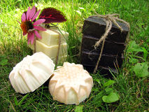 Natural handmade Castilian and tar soap bandaged with string on. Natural handmade Castilian and tar soap on grass background. Soap bars lined with stack and Stock Photography