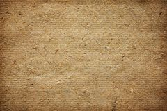 Natural handmade paper for texture or background. Natural handmade paper with visible plant fibers, texture or background Royalty Free Stock Photo