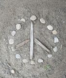 Natural handmade peace sign in the dirt Royalty Free Stock Images