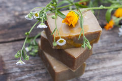 Natural handmade soap with calendula on a light background. Royalty Free Stock Photo
