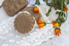 Natural handmade soap with calendula on a light background Royalty Free Stock Images