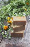 Natural handmade soap with calendula on a light background Stock Photography