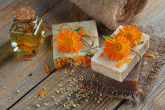 Natural handmade soap with calendula (pot marigold). On rustic wooden background Royalty Free Stock Photo
