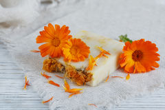 Natural handmade soap with calendula. (pot marigold) on white wooden background Royalty Free Stock Image