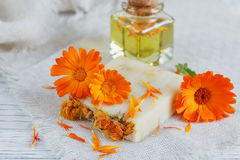 Natural handmade soap with calendula. (pot marigold) on white wooden background Stock Photos