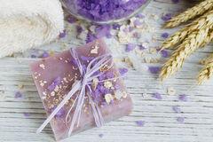 Natural handmade soap, sea salt, towel, oat flakes and wheat ear Stock Images