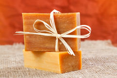 Natural handmade soap tied with a ribbon. On a linen fabric Stock Photography