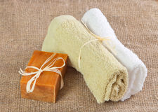 Natural handmade soap and towels. Aromatic natural handmade soap and  towels on the linen cloth Stock Photo