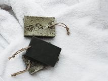 Natural handmade soap on a on white towel stock photos