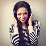 Natural happy emotion woman listening the music holding the hand Stock Photos