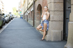 Natural happy young girl talking in the phone Royalty Free Stock Image
