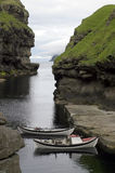 Natural harbour. Two traditional boats in a natural harbour, Faroe Island Stock Images