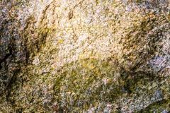 Natural hard rock or stone texture surface as background.  Royalty Free Stock Photo