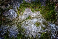 Natural hard rock or stone texture surface as background. Darken from center Royalty Free Stock Photo