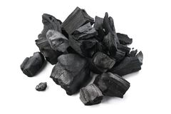 Natural hardwood charcoal. Isolated on white background. Natural hardwood charcoal isolated on white background royalty free stock photography
